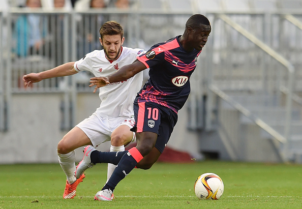 BORDEAUX, FRANCE - SEPTEMBER 17: (THE SUN OUT, THE SUN ON SUNDAY OUT) Adam Lallana of Liverpool competes with Henri Saivet of FC Girondins de Bordeaux during the UEFA Europa League match between FC Girondins de Bordeaux and Liverpool FC on September 17, 2015 in Bordeaux, France. (Photo by Andrew Powell/Liverpool FC via Getty Images)